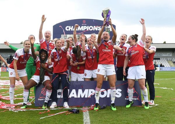 BOREHAMWOOD, ENGLAND - MAY 11: The Arsenal Women lift the WSL Trophy after the match between Arsenal Women and Manchester City Women at Meadow Park on May 11, 2019 in Borehamwood, England