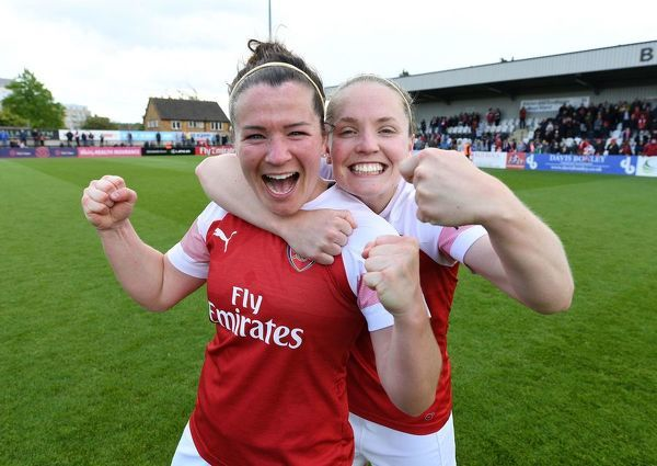 BOREHAMWOOD, ENGLAND - MAY 11: Emma Mitchell and Kim Little of Arsenal celebrate after the match between Arsenal Women and Manchester City Women at Meadow Park on May 11, 2019 in Borehamwood, England