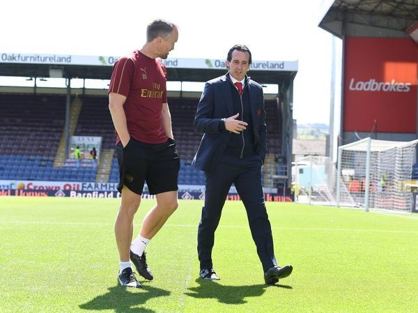 BURNLEY, ENGLAND - MAY 12: Arsenal Head Coach Unai Emery with Head of Performance Darren Burgess before the Premier League match between Burnley FC and Arsenal FC at Turf Moor on May 12, 2019 in Burnley, United Kingdom