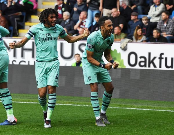 BURNLEY, ENGLAND - MAY 12: (R) Pierre-Emerick Aubameyang celebrates scoring the 1st Arsenal goal with (L) Mo Elneny during the Premier League match between Burnley FC and Arsenal FC at Turf Moor on May 12, 2019 in Burnley, United Kingdom