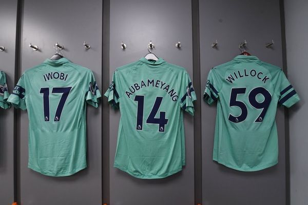 BURNLEY, ENGLAND - MAY 12: Alex Iwobi, Pierre-Emerick Aubameyang and Joe Willock shirts hang in the Arsenal changing room before the Premier League match between Burnley FC and Arsenal FC at Turf Moor on May 12, 2019 in Burnley, United Kingdom
