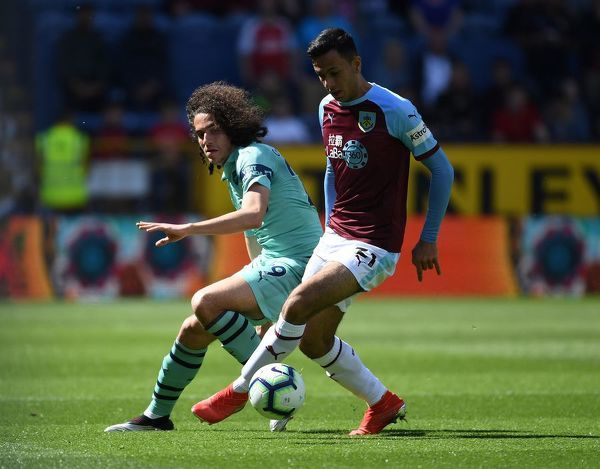 BURNLEY, ENGLAND - MAY 12: Matteo Guendouzi of Arsenal challenges Dwight McNeil of Burnley during the Premier League match between Burnley FC and Arsenal FC at Turf Moor on May 12, 2019 in Burnley, United Kingdom