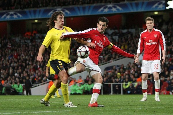 Cesc Fabregas (Arsenal) is fouled by Carles Puyol (Barcelona) resulting in a penalty for Arsenal