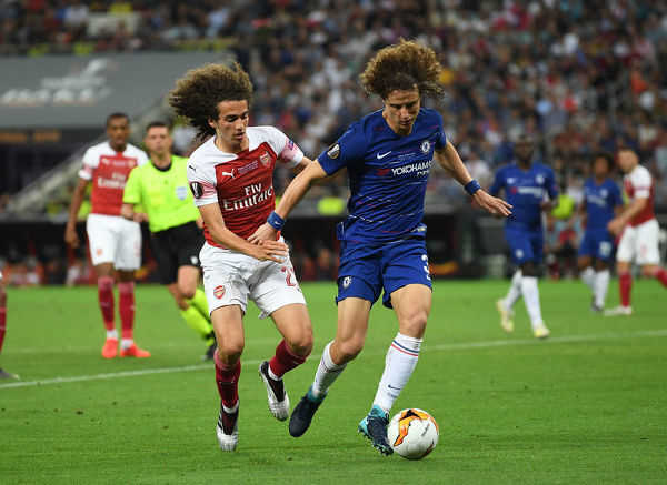 BAKU, AZERBAIJAN - MAY 29: Matteo Guendouzi of Arsenal challenges David Luiz of Chelsea during the UEFA Europa League Final between Chelsea and Arsenal at Baku Olimpiya Stadionu on May 29, 2019 in Baku, Azerbaijan