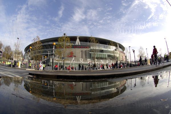 Emirates Stadium reflected in a puddle