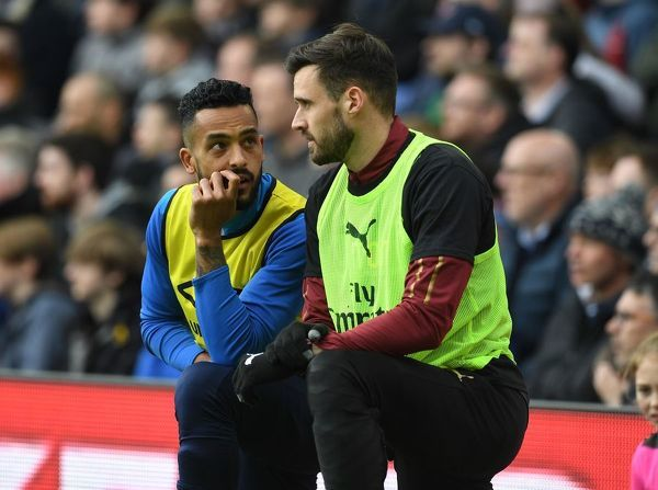 LIVERPOOL, ENGLAND - APRIL 07: Carl Jenkinson of Arsenal chats to Theo Walcott of Everton during the Premier League match between Everton FC and Arsenal FC at Goodison Park on April 7, 2019 in Liverpool, United Kingdom