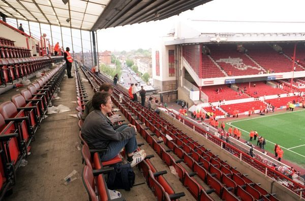 fans sit in the north bank as arsenal stadium