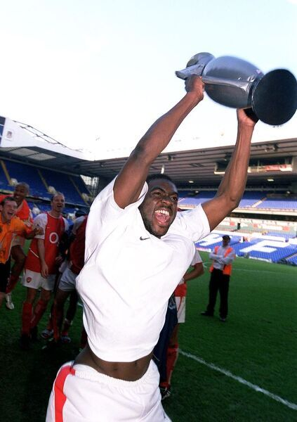 Kolo Toure (Arsenal) celebrates winning the League with an inflatable trophy