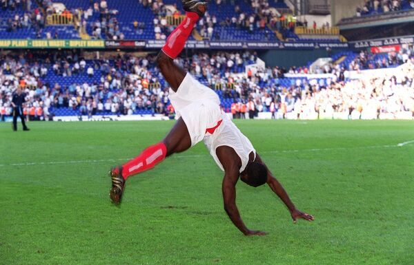 kolo toure celebrates by performing a back flip