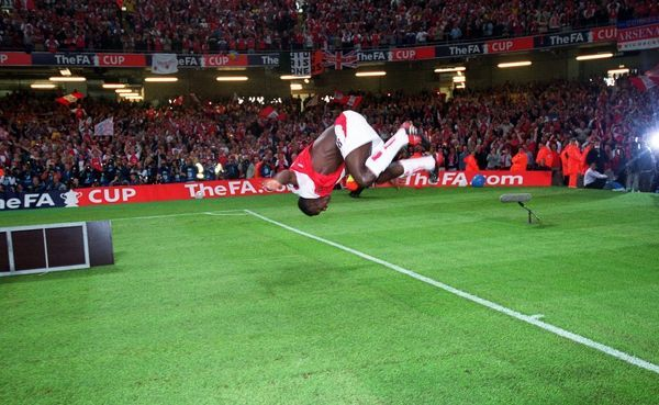 kolo toure does a back flip after the match