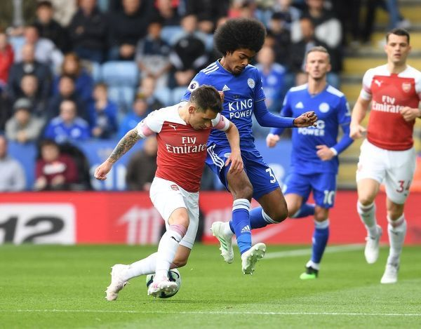 LEICESTER, ENGLAND - APRIL 28: Lucas Torreira of Arsenal breaks past Hamza Choudury of Leicester during the Premier League match between Leicester City and Arsenal FC at The King Power Stadium on April 28, 2019 in Leicester, United Kingdom