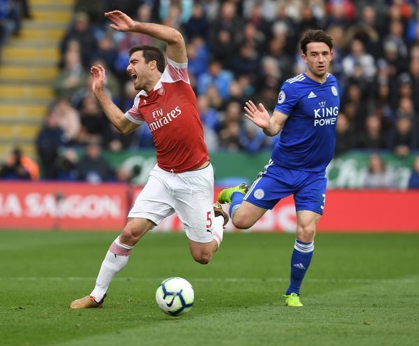 LEICESTER, ENGLAND - APRIL 28: Sead Kolasianc of Arsenal tripped by Ben Chilwell of Leicester during the Premier League match between Leicester City and Arsenal FC at The King Power Stadium on April 28, 2019 in Leicester, United Kingdom