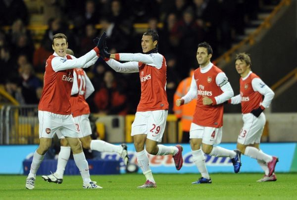 Marouane Chamakh celebrates scoring his and Arsenal's 1st goal with Sebastien Squillaci