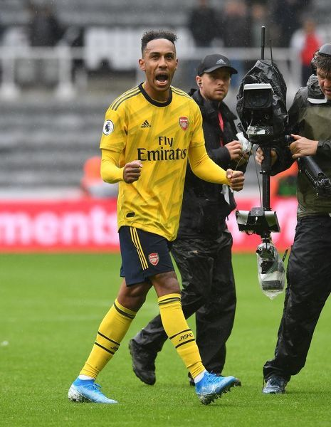 NEWCASTLE UPON TYNE, ENGLAND - AUGUST 11: Pierre-Emerick Aubameyang of Arsenal celebrates in front of the fans after the Premier League match between Newcastle United and Arsenal FC at St. James Park on August 11, 2019 in Newcastle upon Tyne, United Kingdom