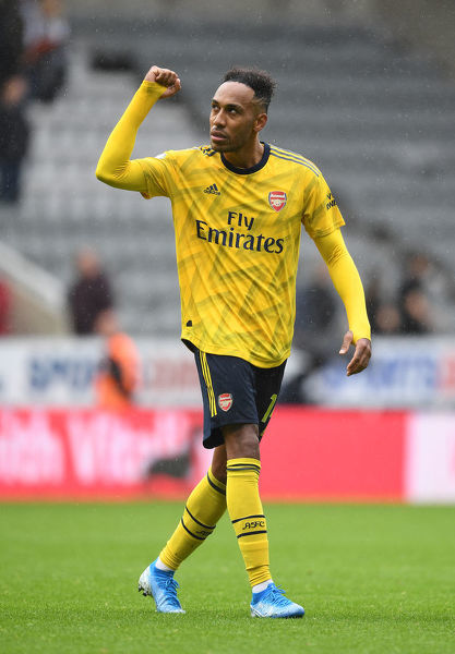 NEWCASTLE UPON TYNE, ENGLAND - AUGUST 11: Arsenal goalscorer Pierre-Emerick Aubameyang celebrates after the Premier League match between Newcastle United and Arsenal FC at St. James Park on August 11, 2019 in Newcastle upon Tyne, United Kingdom