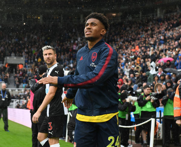 NEWCASTLE UPON TYNE, ENGLAND - AUGUST 11: Arsenal's Joe Reiss Nelson walks out before the Premier League match between Newcastle United and Arsenal FC at St. James Park on August 11, 2019 in Newcastle upon Tyne, United Kingdom