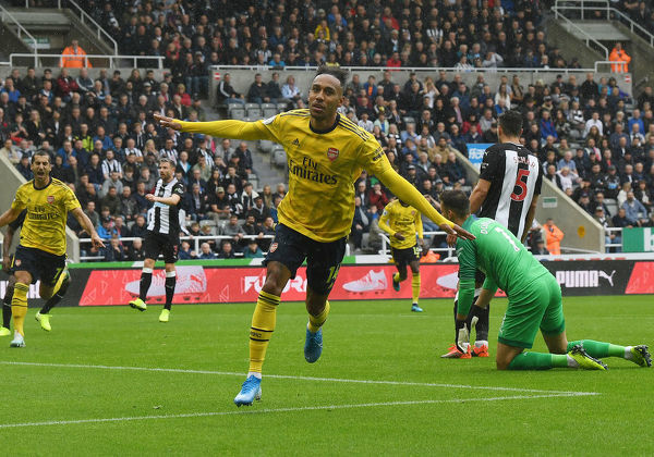 NEWCASTLE UPON TYNE, ENGLAND - AUGUST 11: Pierre-Emerick Aubameyang celebrates scoring the Arsenal goal during the Premier League match between Newcastle United and Arsenal FC at St. James Park on August 11, 2019 in Newcastle upon Tyne, United Kingdom