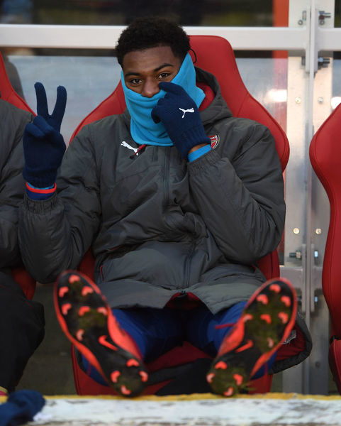 NOTTINGHAM, ENGLAND - JANUARY 07: Arsenal substitute Jeff Reine-Adelaide on the bench before the FA Cup 3rd Round match between Nottingham Forest and Arsenal at City Ground on January 7, 2018 in Nottingham, England