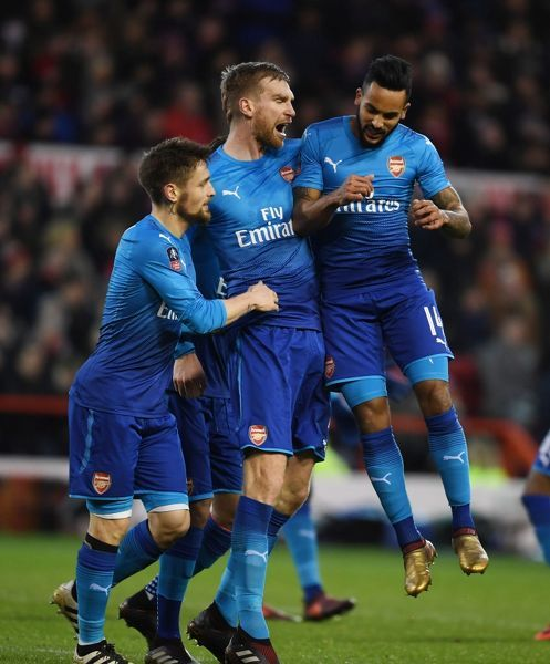 NOTTINGHAM, ENGLAND - JANUARY 07: (2ndL) Per Mertesacker celebrates scoring the 1st Arsenal goal with (L) Mathieu Debuchy and (R) Theo Walcott during the FA Cup 3rd Round match between Nottingham Forest and Arsenal at City Ground on January 7, 2018 in Nottingham, England