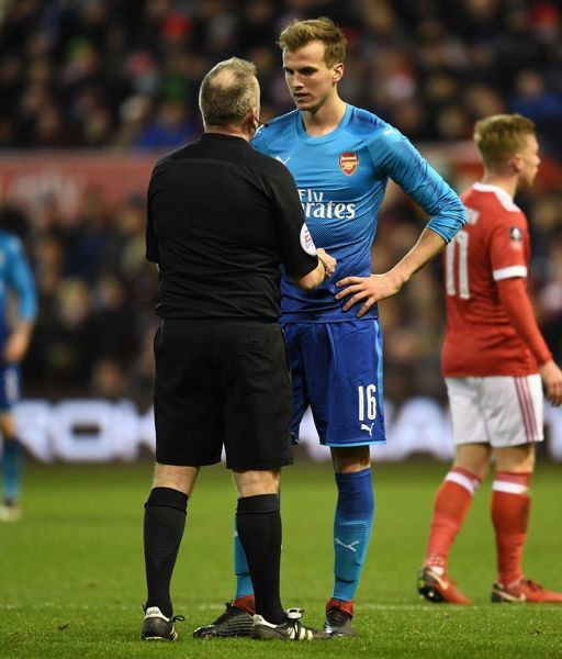 NOTTINGHAM, ENGLAND - JANUARY 07: Arsenal's Rob Holding talks to referee John Moss during the FA Cup 3rd Round match between Nottingham Forest and Arsenal at City Ground on January 7, 2018 in Nottingham, England