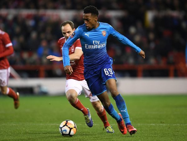 NOTTINGHAM, ENGLAND - JANUARY 07: Joe Willock of Arsenal breaks past David Vaughan of Nottingham Forest during the FA Cup 3rd Round match between Nottingham Forest and Arsenal at City Ground on January 7, 2018 in Nottingham, England