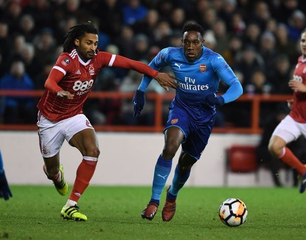 NOTTINGHAM, ENGLAND - JANUARY 07: Danny Welbeck of Arsenal takes on Armand Traore of Nottingham Forest during the FA Cup 3rd Round match between Nottingham Forest and Arsenal at City Ground on January 7, 2018 in Nottingham, England