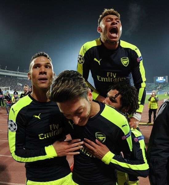 SOFIA, BULGARIA - NOVEMBER 01: (R) Mesut Ozil celebrates scoring the 3rd Arsenal goal with Kieran Gibbs, Mohamed Elneny and Alex Oxlade-Chamberlin during the UEFA Champions League match between PFC Ludogorets Razgrad and Arsenal