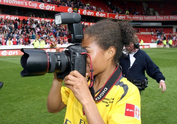 Rachel Yankey (Arsenal) takes a few pictures after the match