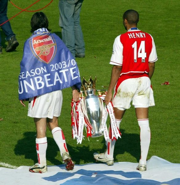 Robert Pires and Thierry Henry with the Premiership trophy