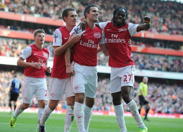 Robin van Persie celebrates scoring his 2nd goal Arsenal's 3rd with Aaron Ramsey and Gervinho