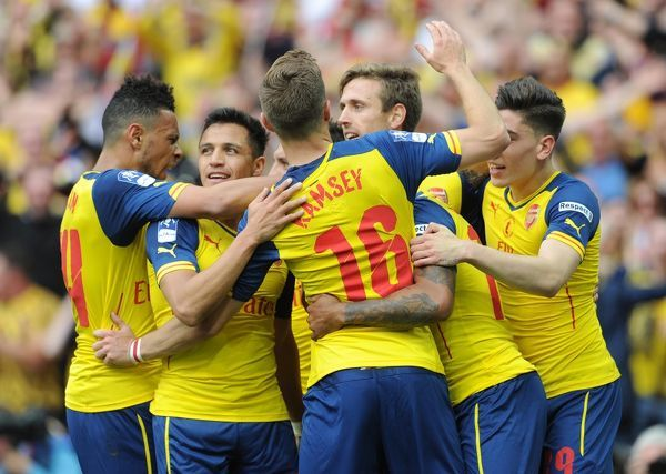 Theo Walcott celebrates scoring Arsenal's 1st goal with his team mates. Arsenal 4:0 Aston Villa. FA Cup Final. Wembley Stadium, 30/5/15. Credit : Arsenal Football Club / David Price