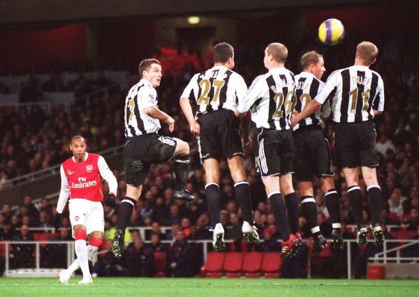 Thierry Henry scores Arsenal's goal from a free kick