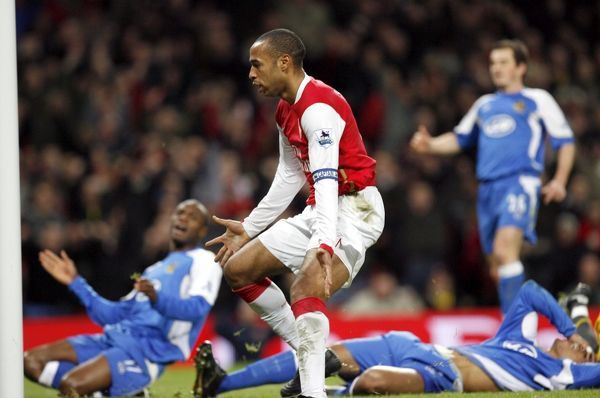 thierry henry watches the ball go into the