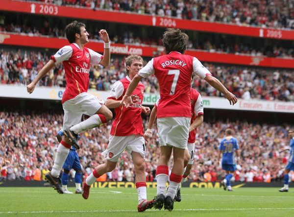Tomas Rosicky celebrates scoring Arsenal's 3rd goal with Cesc Fabregas and Alex Hleb