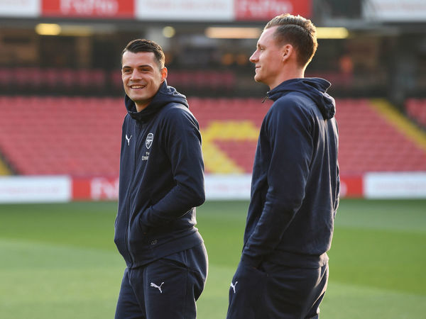 WATFORD, ENGLAND - APRIL 15: Granit Xhaka and Bernd Leno of Arsenal before the Premier League match between Watford FC and Arsenal FC at Vicarage Road on April 15, 2019 in Watford, United Kingdom. (Photo by David Price/Arsenal FC via Getty Images)