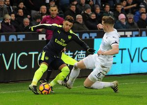 season 2016 17/swansea city v arsenal 2016 17/alex oxlade chamberlain arsenal alfie mawson swansea