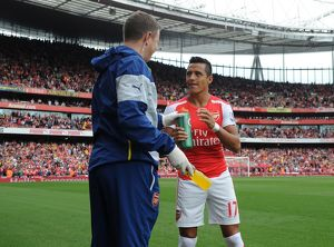 season 2014 15/arsenal v manchester city 2014 15/alexis sanchez arsenal arsenal physio colin lewin match