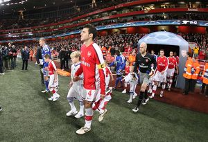 Arsenal captain Cesc Fabregas leads out the team for the first time