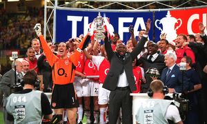 Arsenal captain Patrick Vieira and vice-captain David Seaman lift the FA Cup