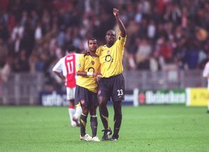 Arsenal captain Sol Campbell and Ashley Cole celebrate after the match