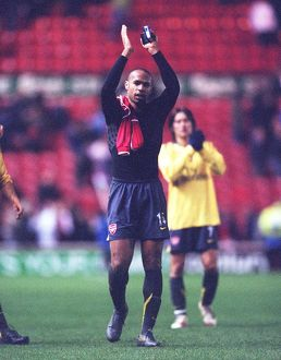 Arsenal captain Thierry Henry waves to the fans after the match