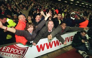 Arsenal fans celebrate the 3rd Arsenal goal scored by Thierry Henry