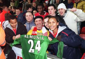 Arsenal fans with Manuel Almunia's shirt after the match