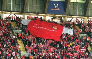 Arsenal fans pass over the giant shirt. Arsenal 2:0 Chelsea. The AXA F