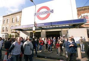Arsenal fans walk outside Arsenal Tube Station before the match