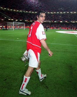 Arsenal goalscorer Robert Pires with the F.A. Cup
