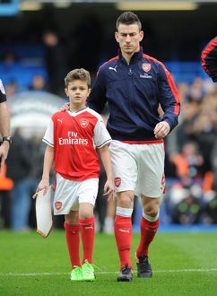 arsenal mascot with laurent koscielny arsenal