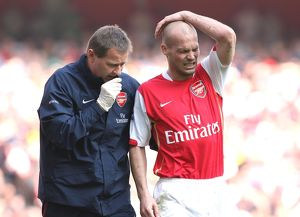Arsenal physio Gary Lewin treats Freddie Ljungberg