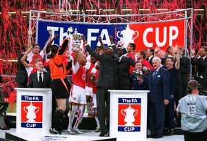 The Arsenal players celebrate lifting the FA Cup Trophy