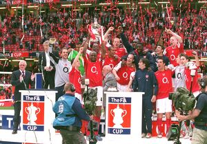 trophies/arsenal players celebrate winning fa cup trophy
